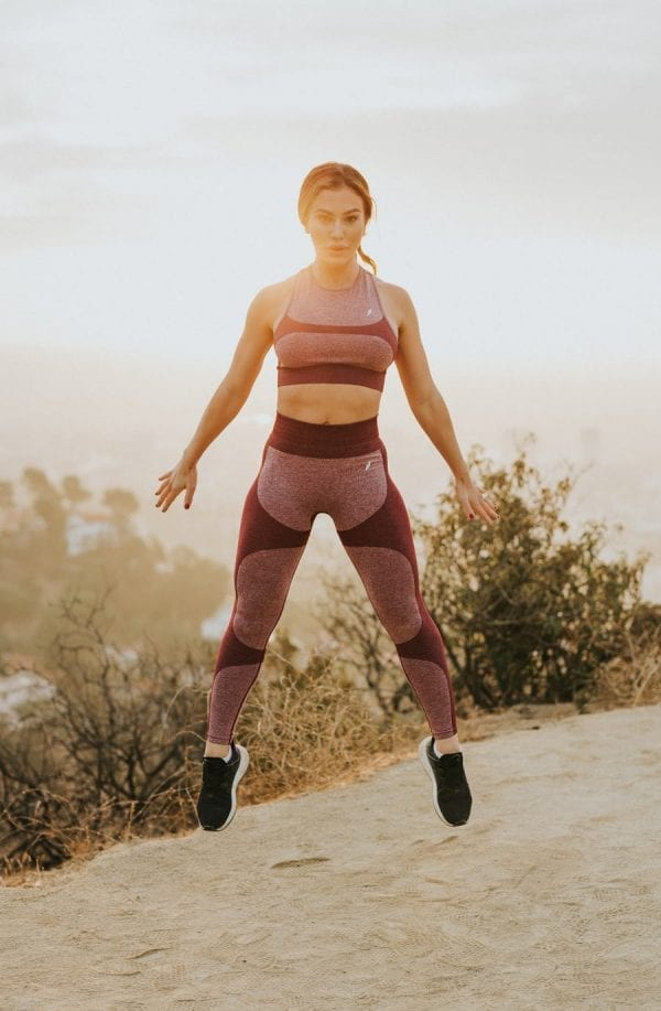 Middle Aged Woman Trains with Fitness Consultation
